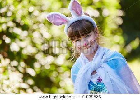 Girl with bunny constume and face paint