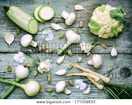 White Vegetables, Fruits And Flowers On Wooden Background - Cauliflower, Parsley, Onion, Garlic, Mus