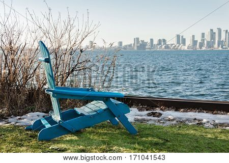 Blue chair on the waterfront with views of the city