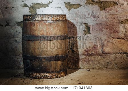 old oak barrels in the cellar in the stone wall background