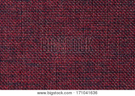 Red and black background with checkered pattern closeup. Structure of the fabric with checkerboard pattern macro.
