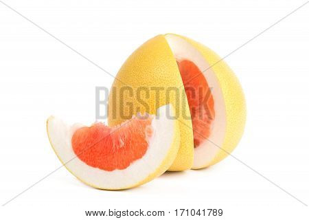 Fruit pomelo lies on a white background.Juicy red pulp