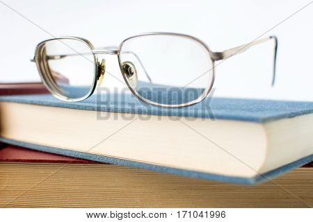 Reading Glasses On Top Of Book