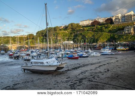 mast ship fishing boats and yachts in the harbor of Ilfracombe. Low tide. North Devon. UK