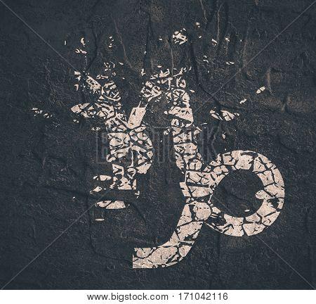 Astrological symbol. Capricorn sign. Grunge splatter texture