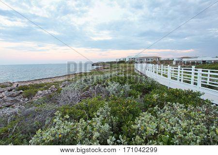 Boardwalk along rocky shorelines at sunset in Cayo Guillermo Cuba