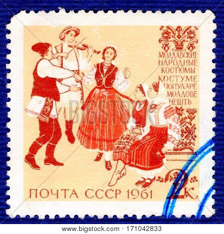 USSR - CIRCA 1961: Postage stamp printed in USSR shows image of musicians and dancers in Moldovan traditional and historic folk costumes, from the series