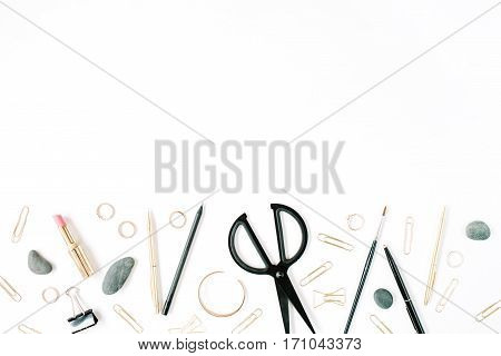 Home office workspace with scissors clips and female accessories. Flat lay top view. Blog header or hero.