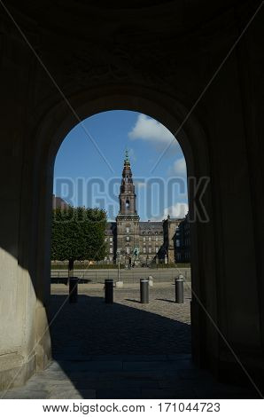 A view through an arch toward the palace at Christiansborg