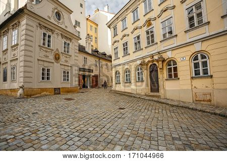 VIENNA/ AUSTRIA - FEBRUARY, 22, 2016: Medieval buildings of the 18th and 19th century in the historical city center of Vienna, Austria. The House on the left is famous Dreimaederlhaus.