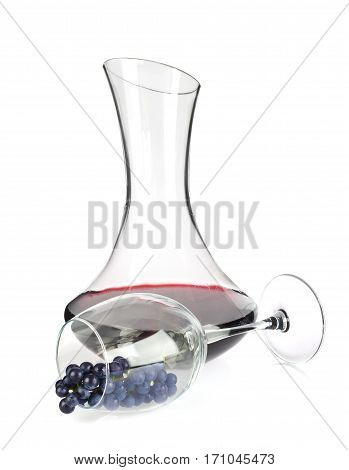 Decanter with wine and grapes in wineglass. Isolated on white background