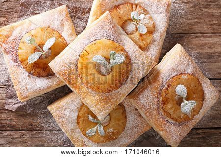 Puff Pastry Cake With Pineapple, Decorated With Mint And Powdered Sugar Close-up. Horizontal Top Vie