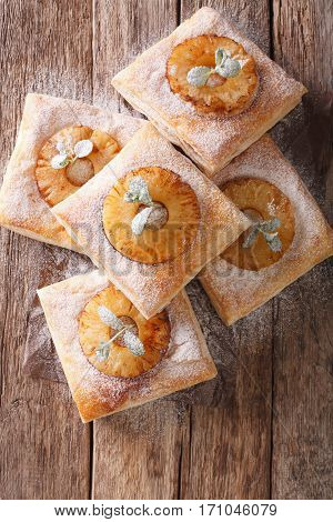 Freshly Baked Puff Pastry Pies With Pineapple Close-up. Vertical Top View