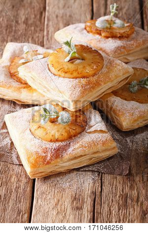 Sweet Puff Pastry Cake With Pineapple, Decorated With Mint Close-up On The Table. Vertical
