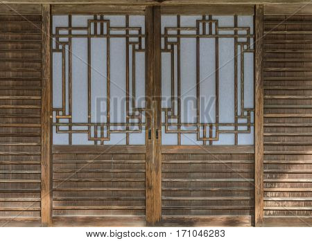 Japanese traditional sliding paper door with sunlight