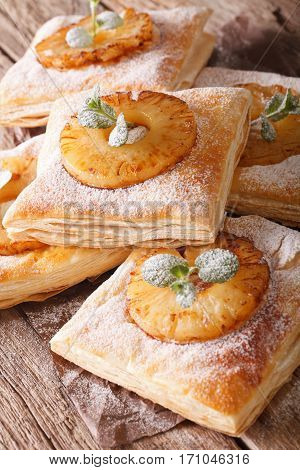 Puff Pastry Pies With Pineapple, Decorated With Mint Close Up. Vertical