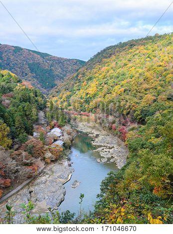 Beautiful aerial scenery of Asashiyama mountain and Hozugawa river in autumn season Kyoto, Japan