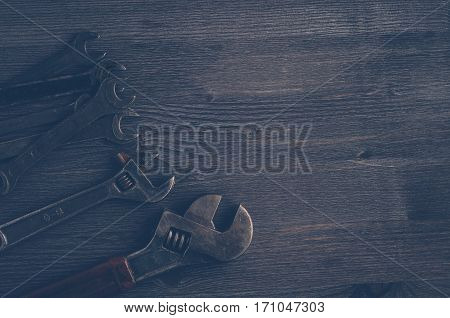 Old Tools On A Dark Wooden Background. Top View