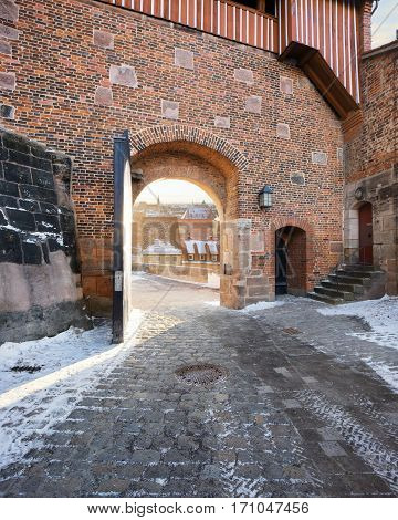 Castle of Nuremberg. Open arched gate leading to panoramic viewpoint over town. Winter landscape, Bavaria, Germany