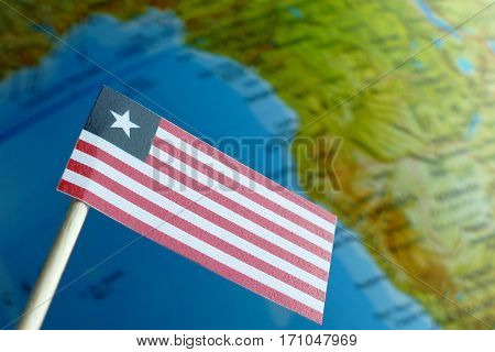 Liberia Flag With A Globe Map As A Background Macro