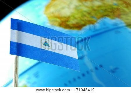 Nicaragua Flag With A Globe Map As A Background Macro