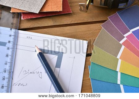 Closeup Table With House Plan And Tools Of A Decorator