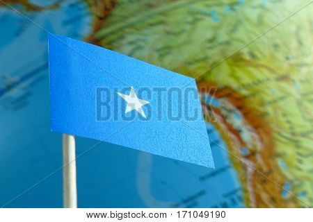 Somalia Flag With A Globe Map As A Background Macro