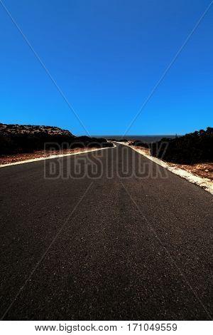 Black Asphalt road landscape scene and blue sky in summer day