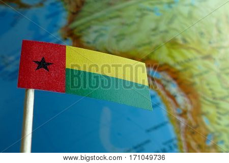 Guinea Bissau Flag With A Globe Map As A Background Macro