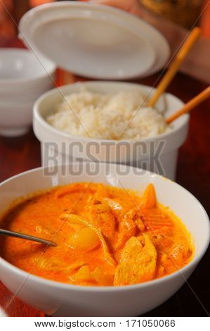 Curry Chicken With Rice Served In Bowl