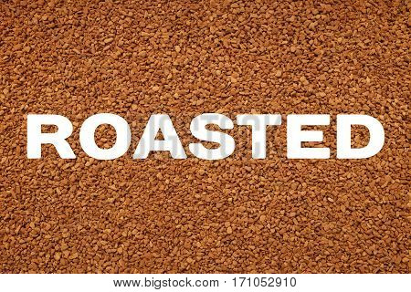 Roasted Text Across Instant Coffee Granules Background