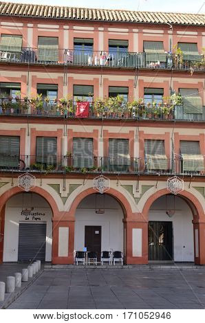 CORDOBA, SPAIN - DECEMBER 27, 2015: Houses in Plaza of the Corredera in Cordoba Andalusia Spain.