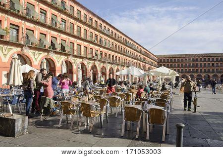 CORDOBA, SPAIN - DECEMBER 27, 2015: Outdoors restaurants in Corredera Plaza in Cordoba Andalusia Spain.