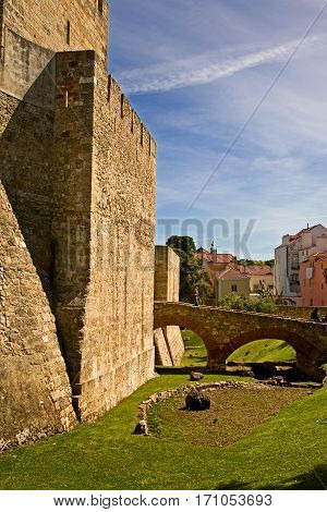 Castle keep at Sao Jorge castle in Lisbon, Portugal, complete with moat.
