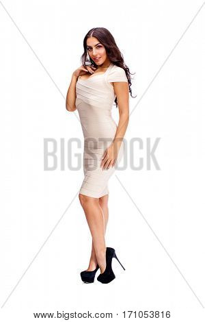 Young arabic woman in beige sexy dress, isolated on white background