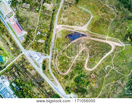 motor and auto tracks in suburb field, top view, aerial photo