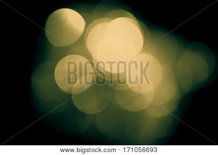 Vintage blurred lights, bokeh effect. Real photo background. Isolated on black