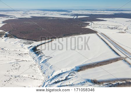Highway in the winter countryside with a bird's-eye view