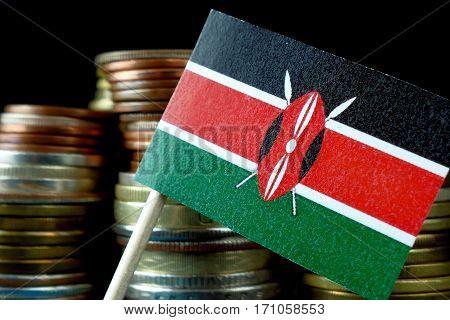 Kenya Flag Waving With Stack Of Money Coins Macro