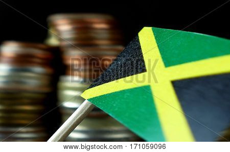 Jamaica Flag Waving With Stack Of Money Coins Macro