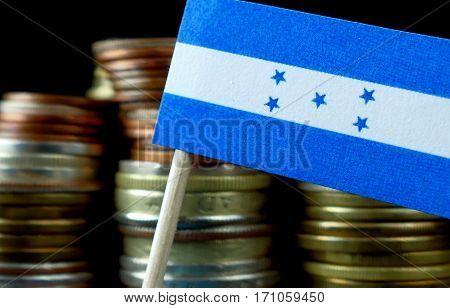 Honduras Flag Waving With Stack Of Money Coins Macro