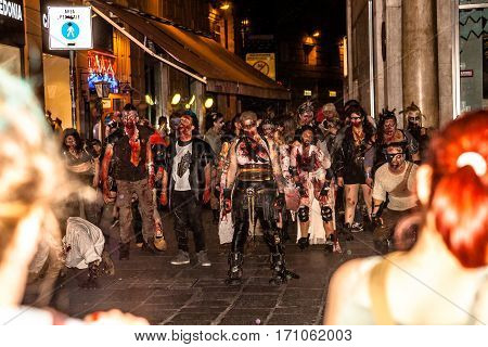 Bologna Italy - May 21 2016: Bologna zombie apocalypse walk a group of people dressed as zombies and scary expressions during a parade through the center of the city.