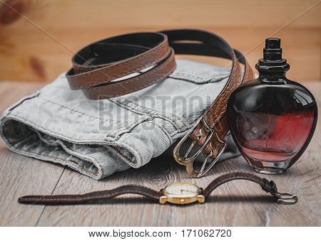 Female stylish romantic summer clothes collection in wooden background