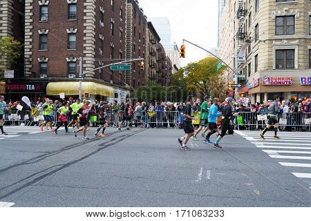 Marathoners and spectators at 16th mile in the Upper East Side, New York City Marathon - November 6, 2016, First avenue and 65th, New York City, NY, US