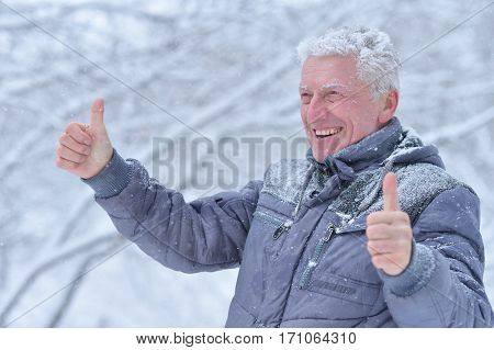 mature man portrait close up, outdors in winter