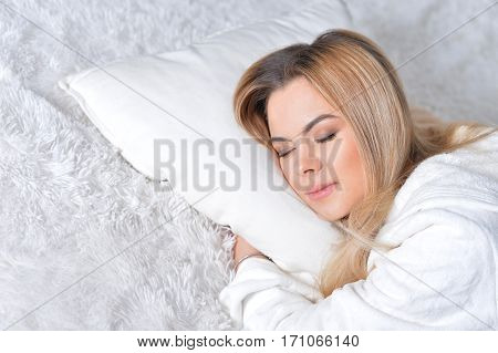 Portrait of a beautiful blonde girl sleeping in bed