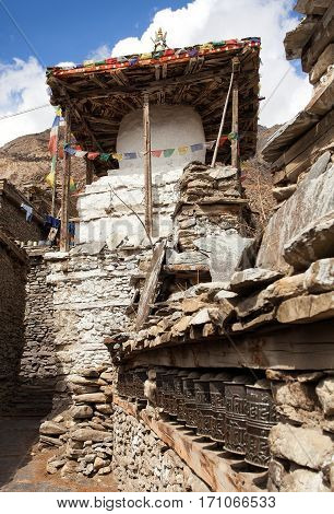 Stupa and prayer wheels wall in Manang villlage one of the best villages in round Annapurna circuit trekking trail route Nepal