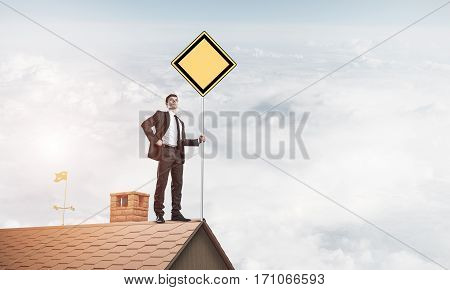 Man in suit holding empty yellow sign on stick. Mixed media