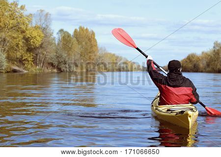 Journey down the river on a sunny day in a canoe.