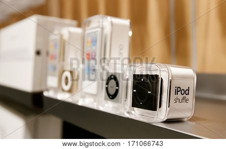 New York February 9 2017: New iPod Shuffle and iPod Nano mp3 players stand on a shelf in Apple store on 5th Avenue in Manhattan.